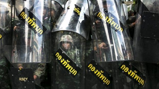 Thai soldiers confront anti-coup protesters in Bangkok.