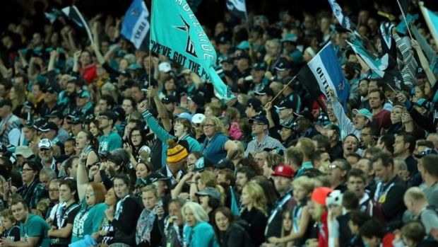 Port fans cheer on their team at the Adelaide Oval on Saturday. The AFL says attendances at the games during the three ...