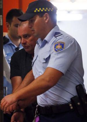 Arrested over the alleged murder of Mr Gao: Glen McNamara is escorted from Kogarah local court.
