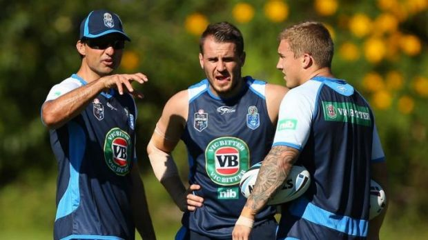 Laurie Daley talks to Josh Reynolds and Trent Hodkinson on Saturday.