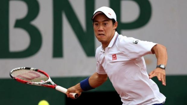 Kei Nishikori of Japan hits a forehand against Martin Klizan.
