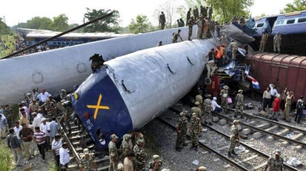 Crushing impact ... Indian officials and rescuers work near the wreckage of the Gorakhpur Express passenger train after ...