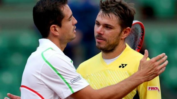 Shock exit: Stanislas Wawrinka of Switzerland shakes hands at the net with Guillermo Garcia-Lopez.