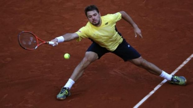 Booed: Stanislas Wawrinka returns the ball.