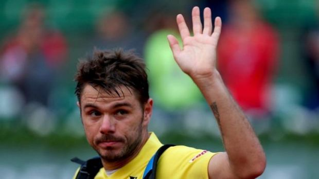 Stanislas Wawrinka leaves court after his first-round defeat.