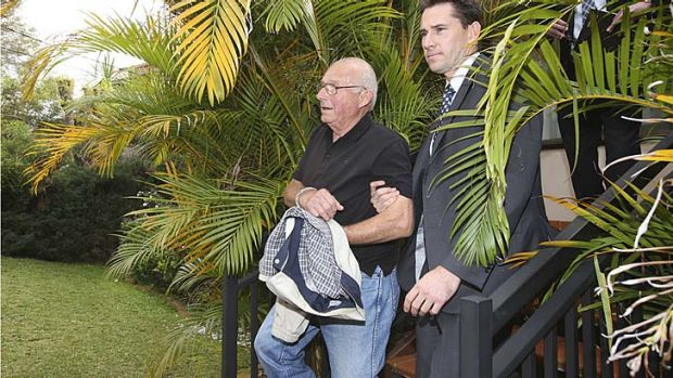 Handcuffed: Detectives arrest Roger Rogerson.