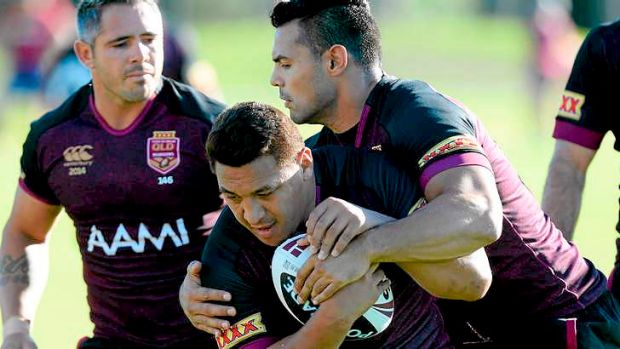 Queensland Maroons ... Josh Papalii runs into the defence during a recent State of Origin training session.