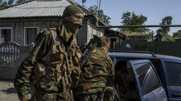 Pro-Russian militia climb into a car after fighting near Sergei Prokofiev International Airport in Donetsk, eastern Ukraine.