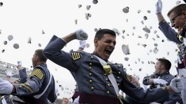 The 2014 graduating class of the US Military Academy  toss their hats during commencement ceremonies, where President ...