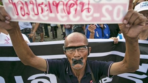 A protester with his mouth taped shut in Bangkok on Wednesday.