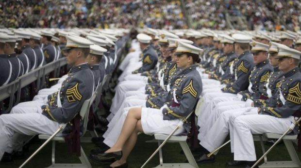 Future tense: members of the 2014 West Point graduating class listen to Mr Obama's speech.