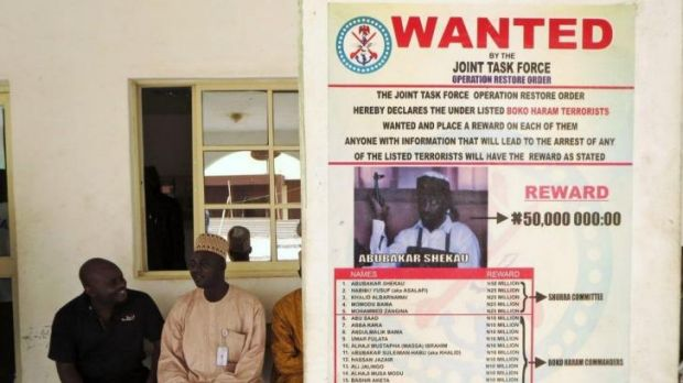 A poster advertising the search for Boko Haram leader Abubakar Shekau and other fighters is pasted on a wall in Baga ...