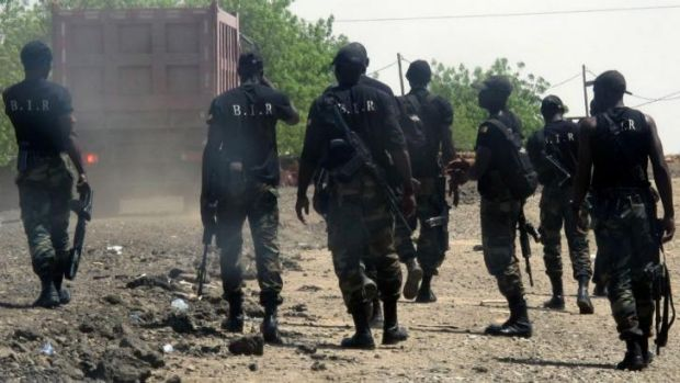 Armed Cameroonian men of the rapid intervention battalion (BIR) patrol for Boko Haram forces in Waza, northern Cameroon.