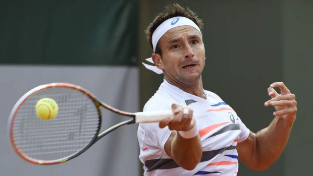Tough loss ... Australia's Marinko Matosevic returns the ball to Great Britain's Andy Murray during their FrenchOpen ...