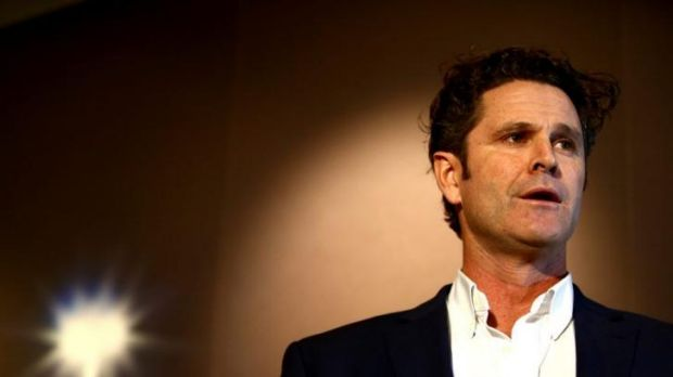 Chris Cairns reads a prepared statement to at a media conference at Auckland Airport.