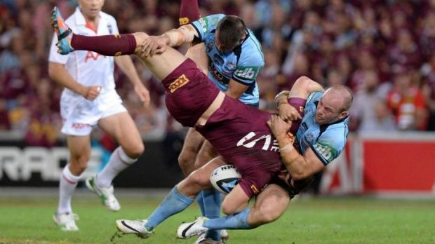Trouble: Brent Tate is upended by Josh Reynolds.
