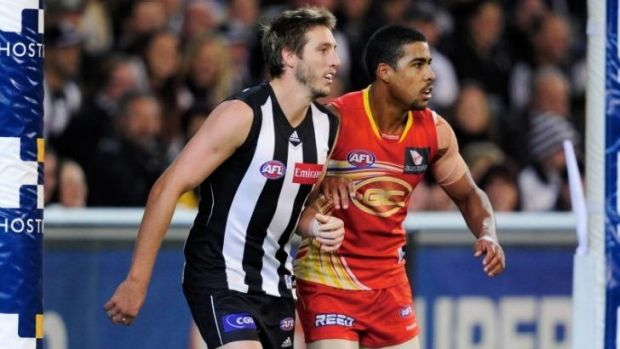 "Joel Wilkinson, right, says his short AFL career at the Suns was ""deeply"" affected by racist taunts."