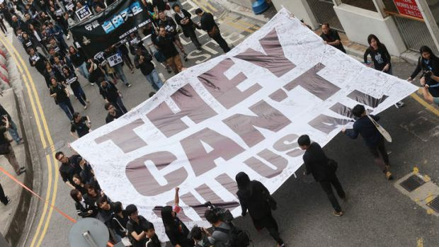 "Members of The Hong Kong Journalists' Association, Staffs of Ming Pao and supporters hold a banner displaying  ""They ..."