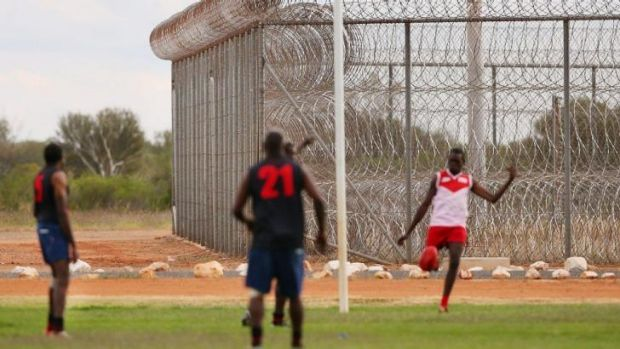 Inmates playing a scratch match of football on Thursday at Alice Springs Correctional Centre, where Liam Jurrah is ...