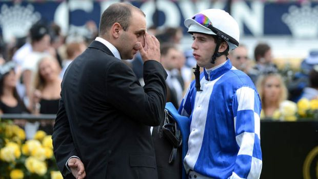 Fateful day: Trainer Con Karakatsanis (left) on Victoria Derby Day at Flemington in 2012.