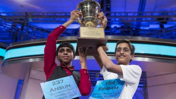 Ansun Sujoe, left, and Sriram Hathwar raise the championship trophy after being named co-champions of America's National ...