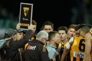 Alastair Clarkson watches on as Brendon Bolton takes charge of the Hawks during this year's NAB Challenge