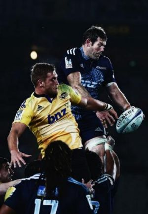 James Broadhurst of the Hurricanes competes with Tom Donnelly of the Blues in the lineout.