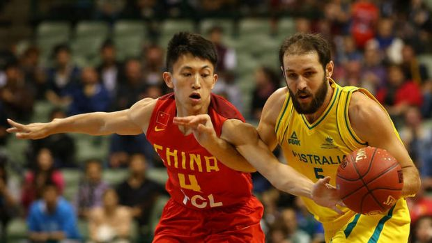 Boomers guard Rhys Martin competes with XiaoYu Liu of China for the ball during the 2014 Sino-Australia Challenge match ...