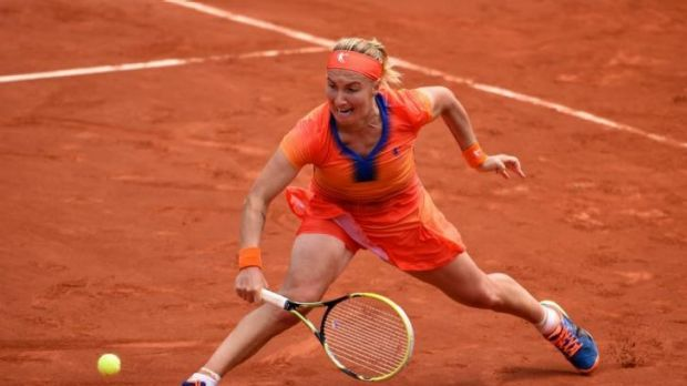 Svetlana Kuznetsova of Russia plays a abackhand against Petra Kvitova of the Czech Republic.
