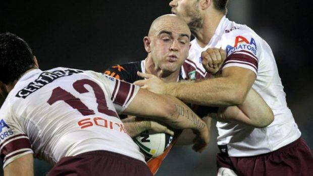 Liam Fulton hits the ball up against Manly.