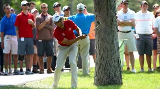 Adam Scott of Australia hits out of trouble on the 17th hole.