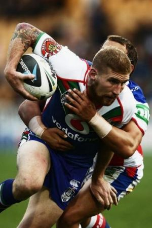 On the charge: Sam Tomkins of the Warriors.