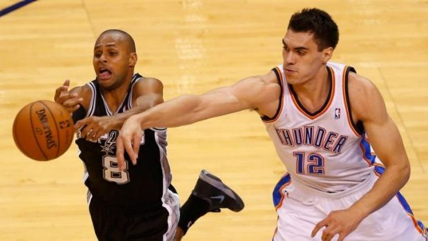 Patrick Mills battles with Steven Adams in game six on Sunday.