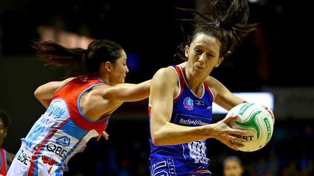 Bailey Mes of the Mystics is put under pressure by Sharni Layton of the Swifts during the round 14 match in Auckland on ...