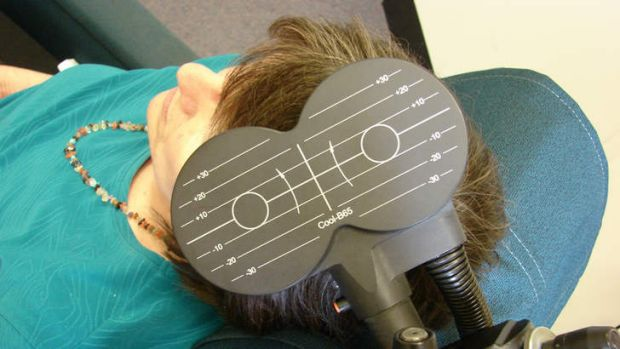 A patient being treated with transcranial magnetic stimulation.