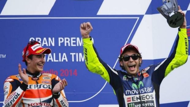 Marc Marquez and Valentino Rossi celebrate on the podium after the Italian MotoGP.