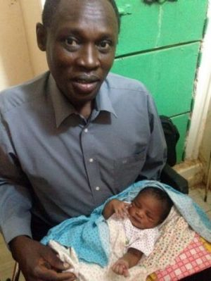 Daniel Wani and his daughter Maya. They are pictured at the women's prison in Omdurman, where Mr Wani's wife, Meriam ...