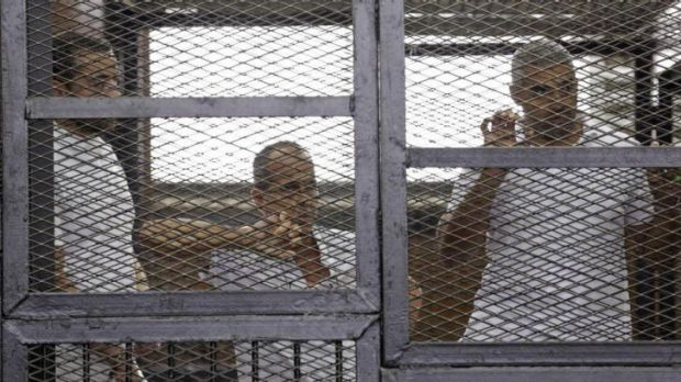 Al-Jazeera journalists Baher Mohamed, Peter Greste and Mohammed Fahmy behind bars in court in Cairo.