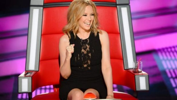 Playful: Kylie Minogue in the judge's chair on <i>The Voice</i>.