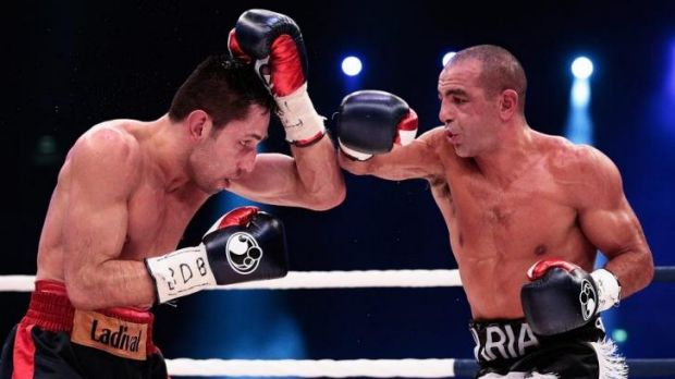 Sam Soliman and Felix Sturm battle it out in the ring.