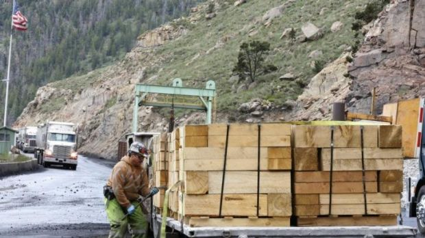 A worker unloads wood at the Sufco Coal Mine in Utah, which produces 30,000 tonnes of low-sulphur coal a day. US ...