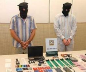Two men arrested in Macau for allegedly planting malware on local ATMs (shown with equipment reportedly seized from ...