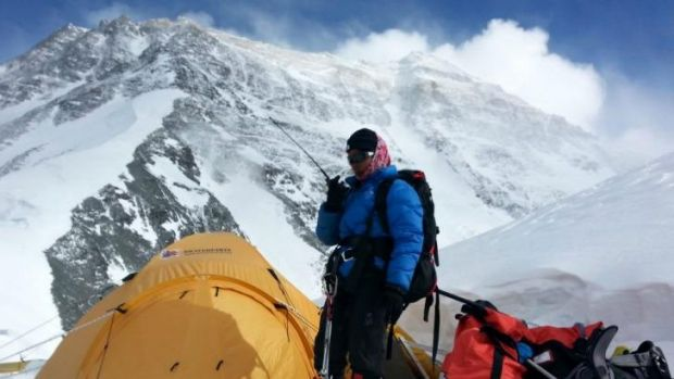 Poorna Malavath uses a radio during her ascent of Mount Everest on the Tibetan side of the mountain in China.