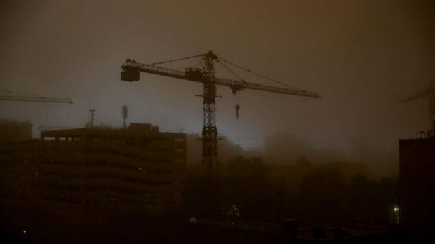 A tower crane is is enveloped in dust in Tehran, Iran on Monday as a sandstorm stings the city's residents with wind ...