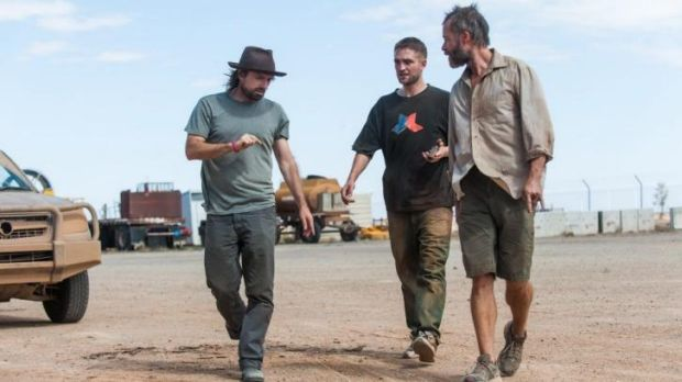 On set: From left, director David Michod, Robert Pattinson and Guy Pearce during filming of <i>The Rover</i>.