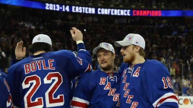 The New York Rangers celebrates making the Stanley Cup playoffs with their defeat of the Montreal Canadiens.