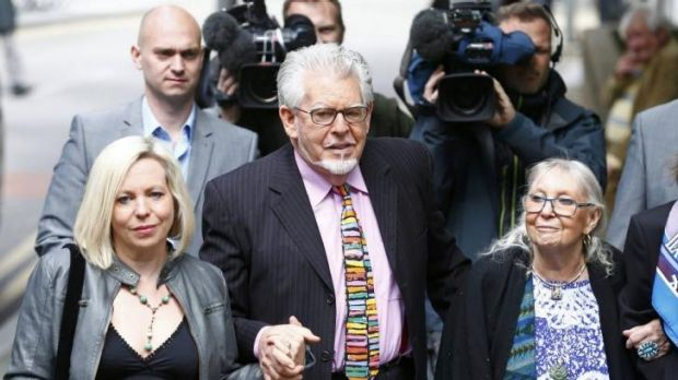 Dark side: Entertainer Rolf Harris arrives with his daughter, Bindi, and wife, Alwen Hughes, at Southwark Crown Court in ...