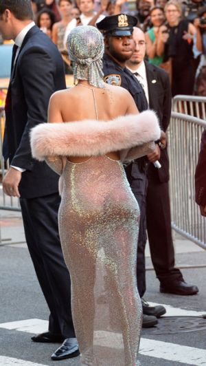 Rihanna's dress catches a local police officer's eye.