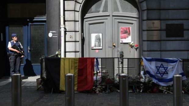 A police officer stands guard in front of the Jewish Museum in Brussels after the fatal shootings on May 24.