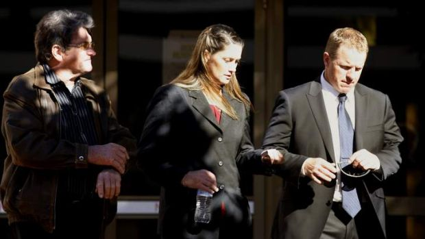 Charged: Police Constable Megan McNamara, centre, leaves Newcastle Local court on Tuesday.